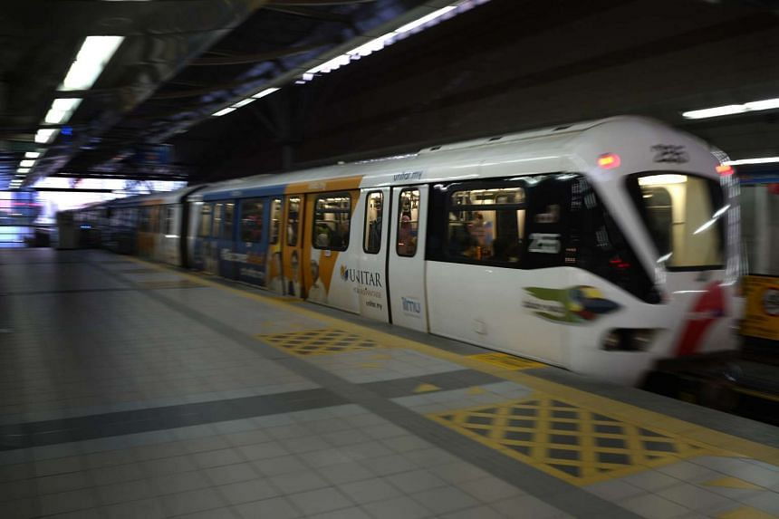 An LRT train leaves KL Sentral station in Kuala Lumpur, Malaysia, on July 19.