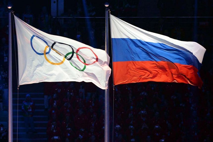 The Olympic and Russian flags during the Opening Ceremony of the Sochi Winter Olympics at the Fisht Olympic Stadium on Feb 7, 2014 in Sochi.