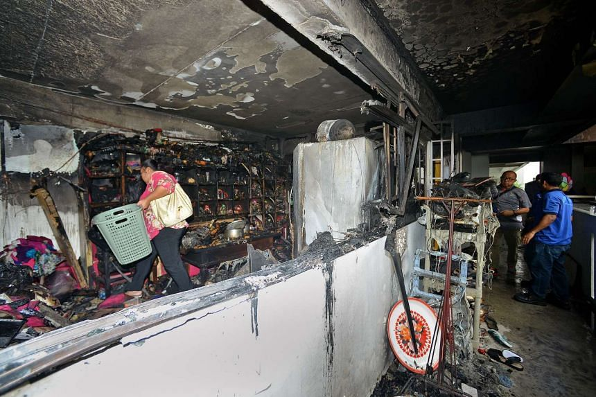 The four-room flat was destroyed by a fire, leaving the family living there to salvage whatever they could.