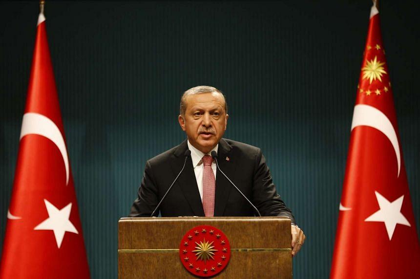 Turkish President Tayyip Erdogan at a news conference in Ankara, on July 20, 2016.