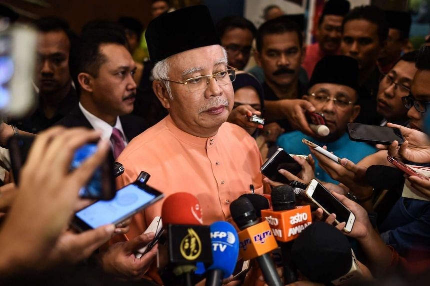 Malaysia's Prime Minister Najib Razak speaks to members of the media after an event in Kuala Lumpur on July 21, 2016.