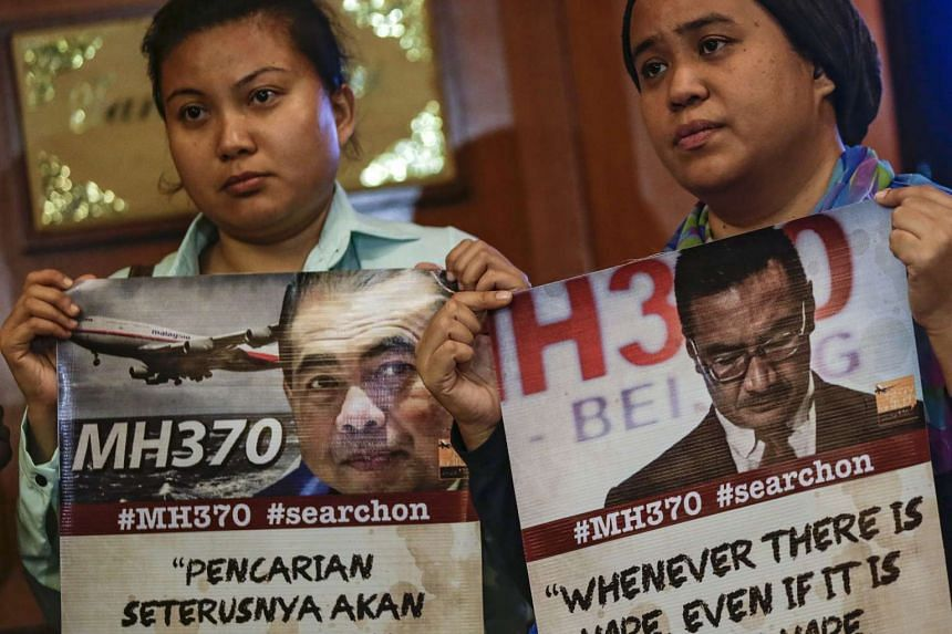 Relatives of MH370 passengers attended a news conference in Kuala Lumpur on July 21, 2016.