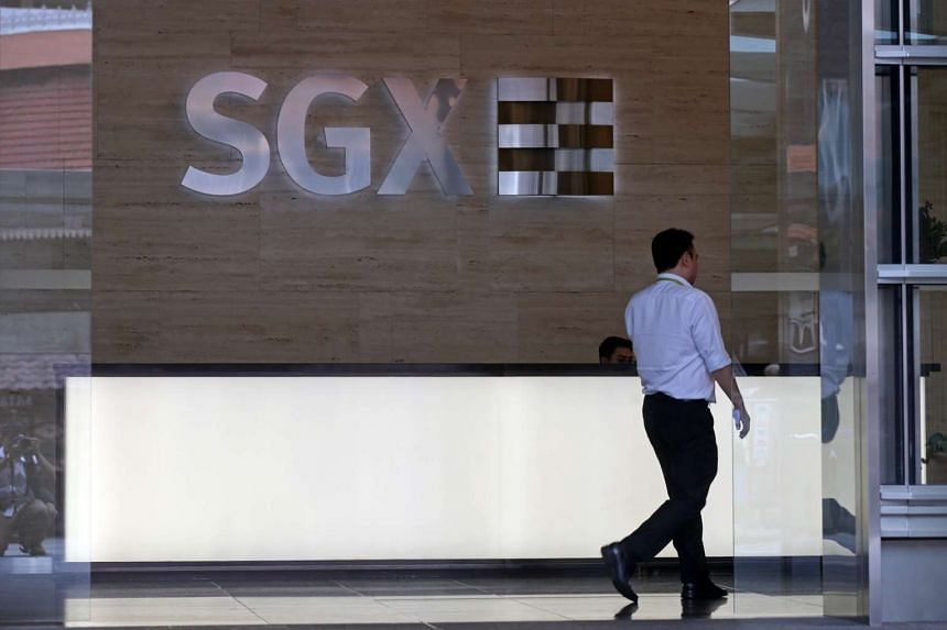 A man walks in the SGX Singapore Exchange building in Singapore's central business district.