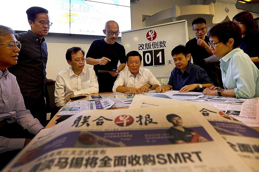 Lianhe Zaobao editor Goh Sin Teck (seated, centre) in discussion with other senior editors on enhancing the paper's reading experience for its audience. The revamped Chinese daily hits the streets today with new content and design.
