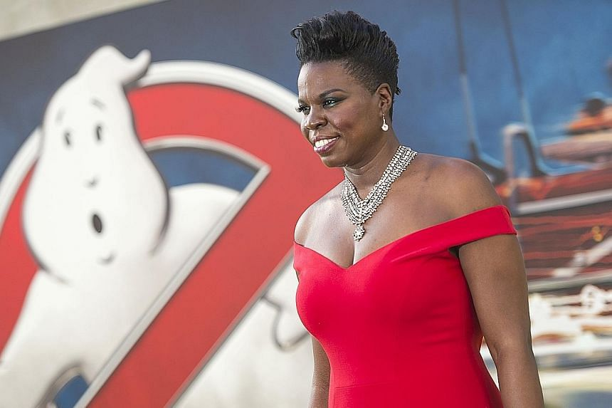 Breitbart news editor Milo Yiannopoulos (above) is accused of leading an online campaign of racial and sexual taunts against Ghostbusters star Leslie Jones (left).