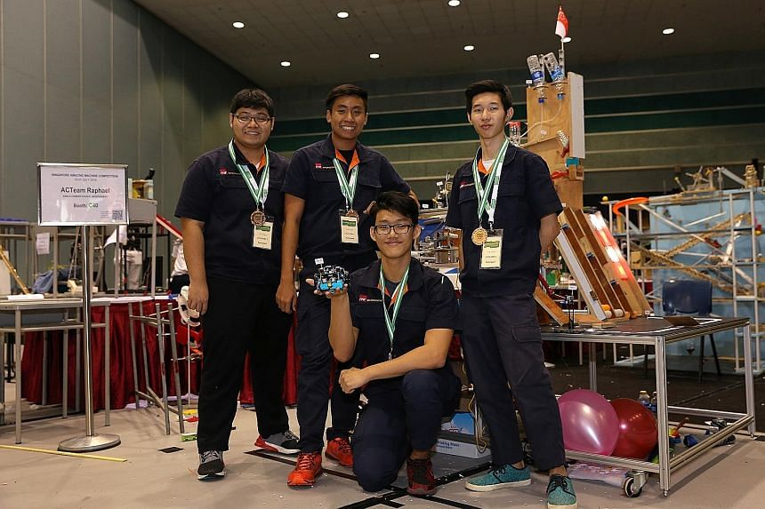 Poh Wei Jie (above, right), 17, the leader of the CCKRanger team from ITE College West, yesterday explaining to Mr Ong Ye Kung, Acting Minister for Education (Higher Education and Skills), the workings of his team's Rube Goldberg machine, which won t