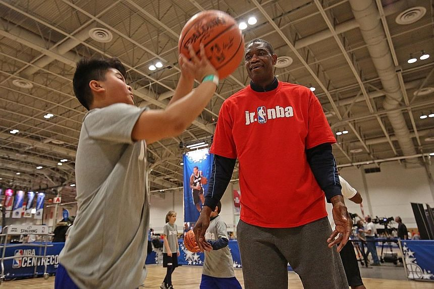 Dikembe Mutombo, one of the NBA's greatest defensive players, teaching kids on Jr NBA Day in February in Toronto.