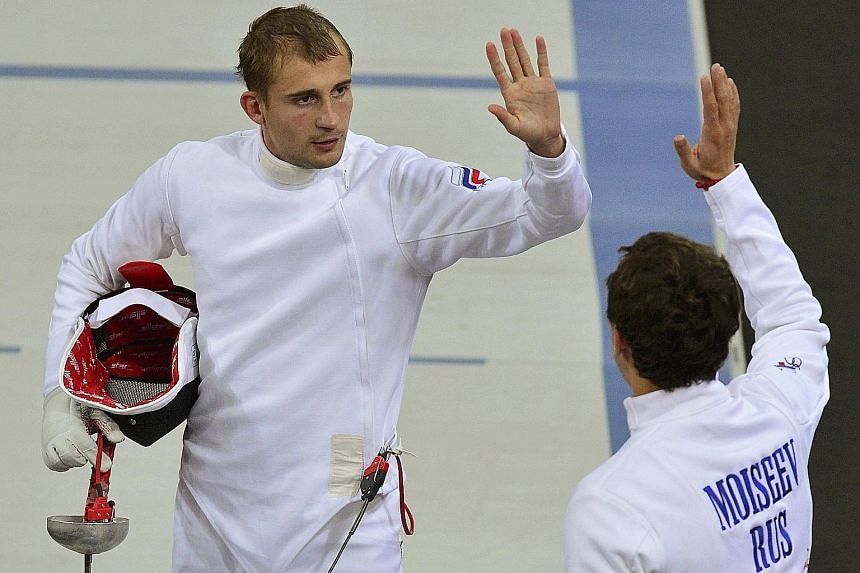 """Russian pentathlete Aleksander Lesun (left), who has said he is still hoping to go to Rio, believes that """"the IOC will understand they can't within the rules exclude an entire country groundlessly""""."""