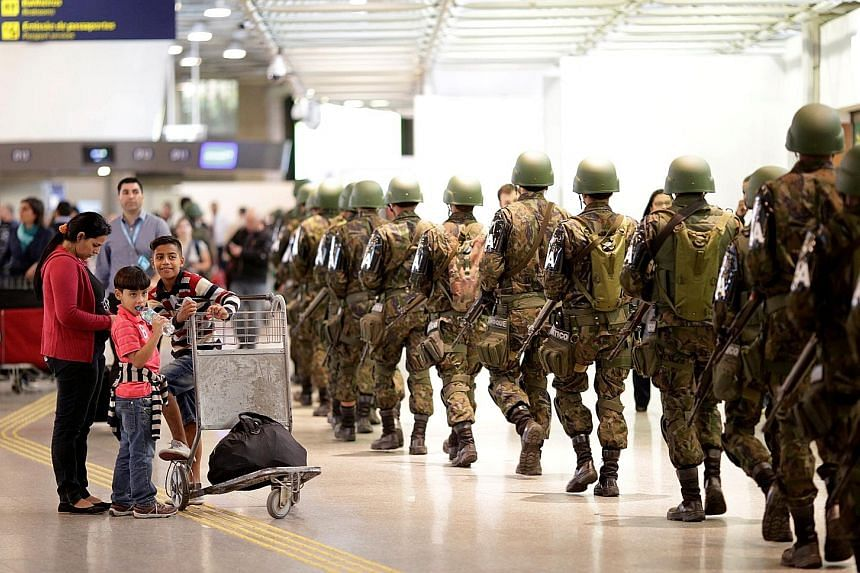 Soldiers patrolling the international airport in Rio de Janeiro on Tuesday. A presumed Brazilian Islamist group has pledged allegiance to ISIS.