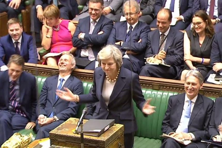 Mrs May speaking during question time at the House of Commons in London yesterday. The new British Prime Minister is meeting German Chancellor Angela Merkel and French President Francois Hollande this week.