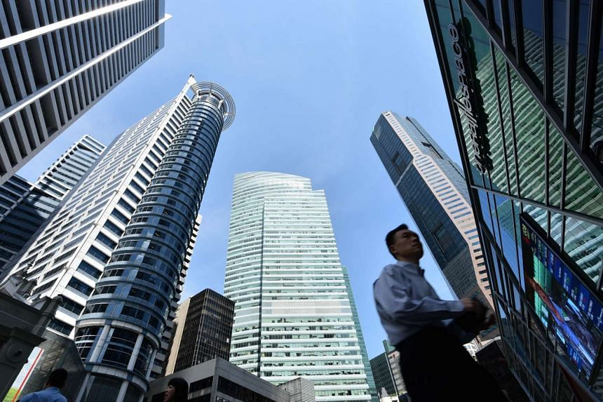 An office worker at Raffles Place, the heart of the central business district in 2015.