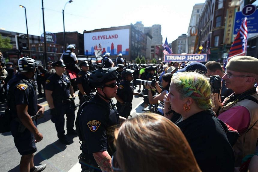 Police, state troopers and other security forces keep people back outside the Quicken Loans Arena in Cleveland on July 20.
