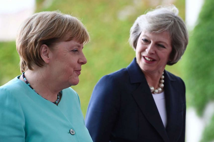 German Chancellor Angela Merkel welcomes British Prime Minister Theresa May on July 20, 2016.