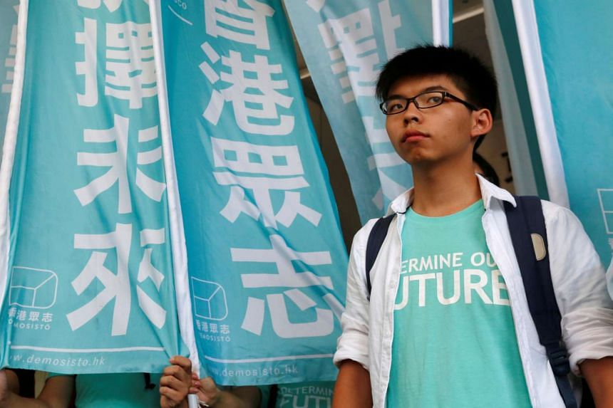 """Student leader Joshua Wong looks on before a verdict, on charges of inciting and participating in an illegal assembly in 2014 which led to the """"Occupy Central"""" pro-democracy movement, outside a court in Hong Kong on July 21."""