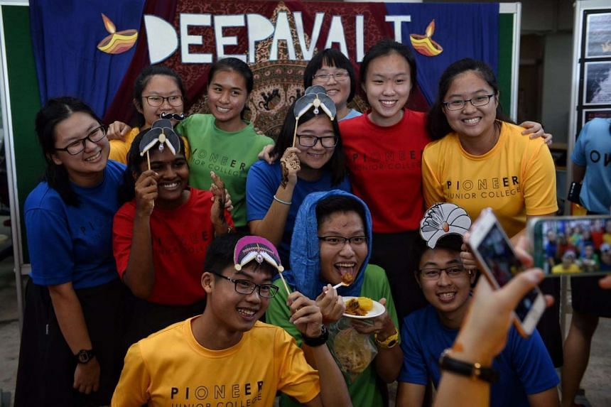 JC students take photographs at a booth during Racial Harmony Day at Pioneer Junior College on July 21, 2016.