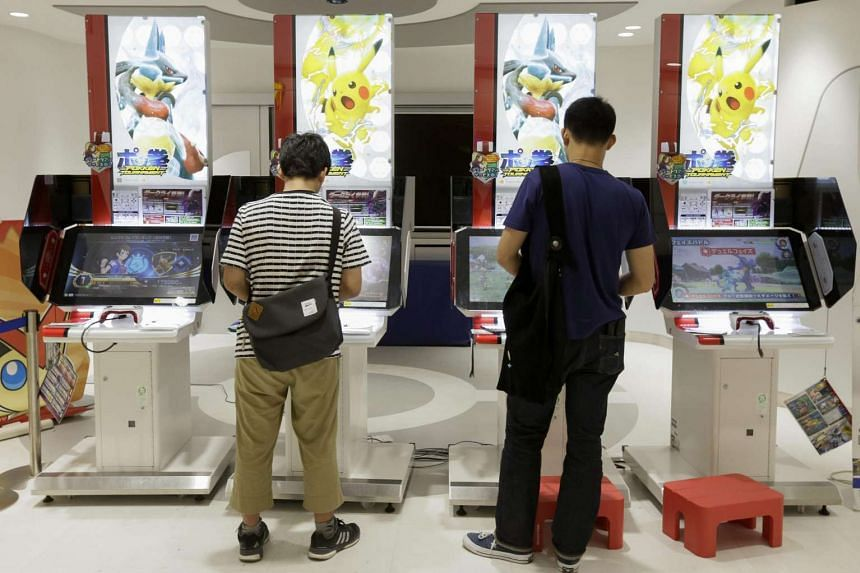 Visitor play video games of Pokemon at a Pokemon Centre in Tokyo, Japan, on July 20.