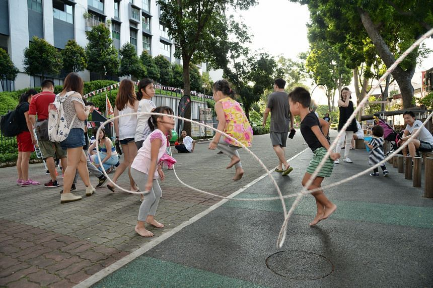Children jumping rope in Duxton Plain at the PlaystreetsSG event last weekend. The initiative by the Singapore Wellness Association aims to get people moving by turning neighbourhood streets into giant playgrounds.
