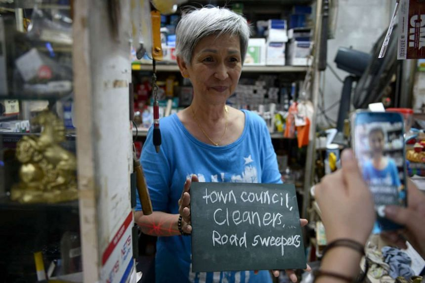 Provision shop owner Ong Siew Hong expressing her thanks to cleaners and road sweepers.