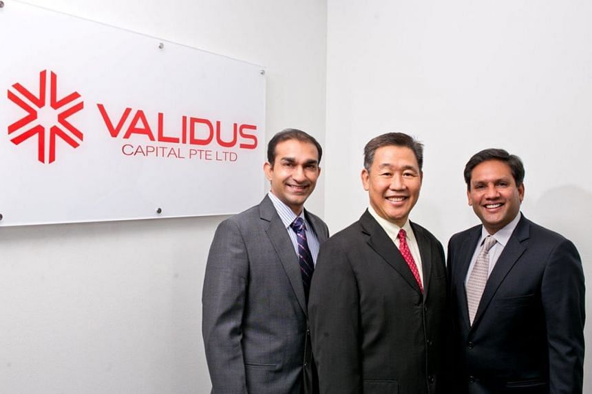 Mr Nahata (left), Mr Richard Hoon, chairman of Validus Capital and Mr Yash Poddar, chief executive, hope that offering insurance to lenders will encourage more participation in the business of invoice financing.