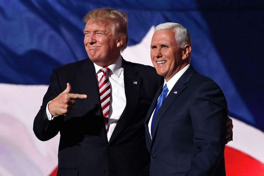 Donald Trump stands with Republican vice presidential candidate Mike Pence and acknowledge the crowd on the third day of the Republican National Convention on July 20 at the Quicken Loans Arena in Cleveland, Ohio.