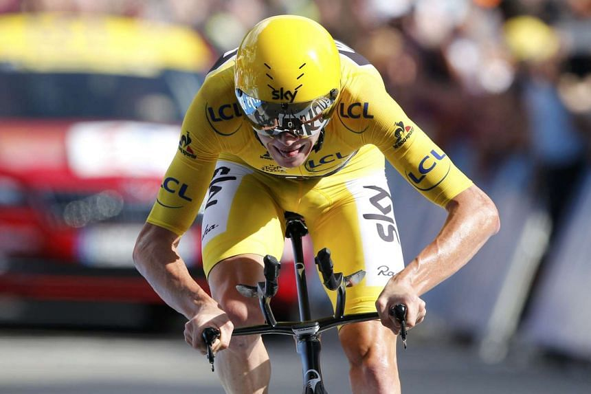 Yellow jersey leader Chris Froome of Britain wins on the finish line during the individual time trial.