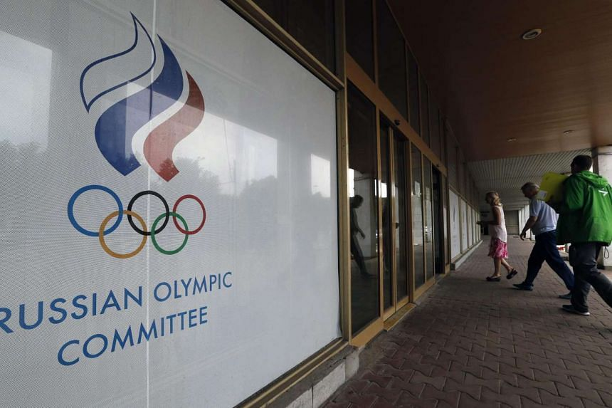 People enter the Russian Olympic Committee headquarters and Russian Athletics Federation office in Moscow.
