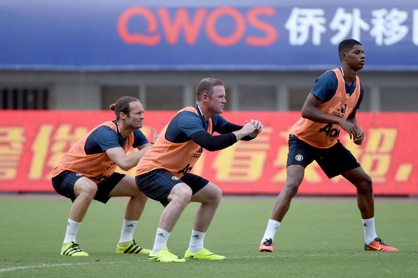 Manchester United's Wayne Rooney (center) attends a training session ahead of the 2016 International Champions Cup football match between Manchester United and Dortmund in Shanghai on July 21.