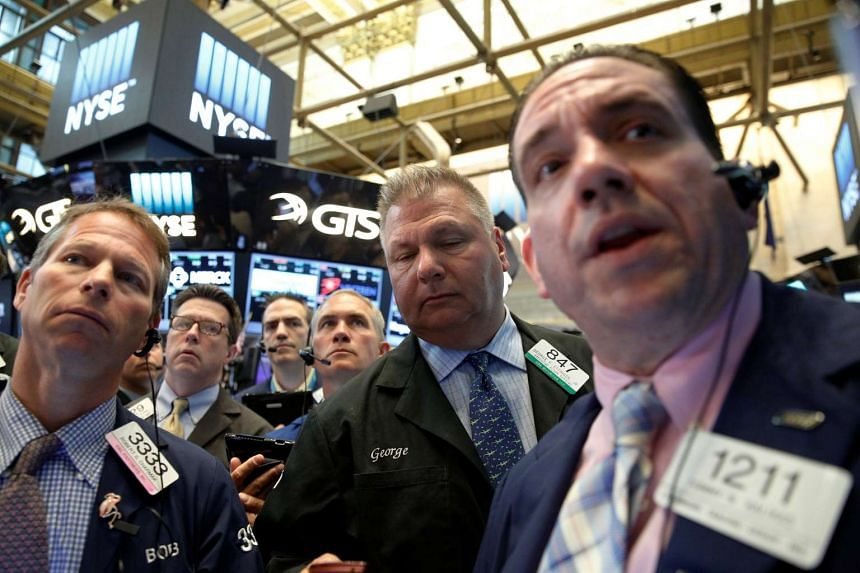 Traders work on the floor of the New York Stock Exchange in New York on July 21, 2016.