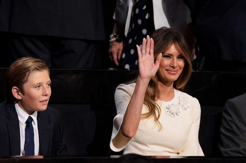 Melania Trump, wife of Republican presidential candidate Donald Trump waves during the evening session as Barron Trump (left) looks on on the fourth day of the Republican National Convention on July 21.