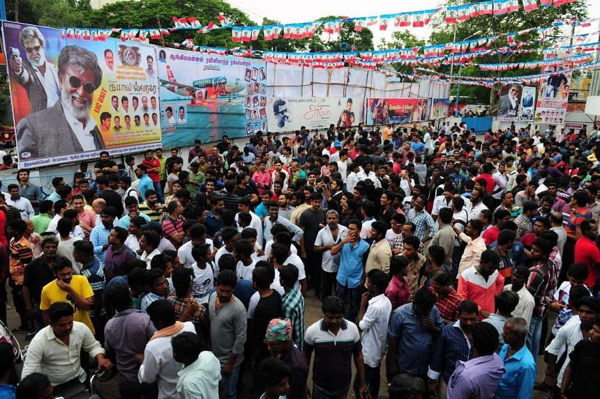 Indian fans of Bollywood star Rajinikanth gather at a cinema on the first day of release of his new Tamil language film Kabali in Chennai, on July 22, 2016.