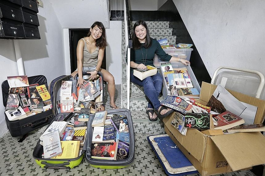 Founders of Books & Beer Eileen Lee (far left) and Melissa Low have 400 books at home that were not taken at the book swop events.