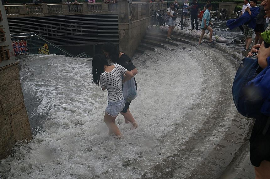 Images of a flooded street in Beijing (above) and a flooded entrance to a subway station in Tianjin (above left), both taken on Wednesday, give an indication of the severity of the heavy rains and flooding that have hit northern China since Monday.