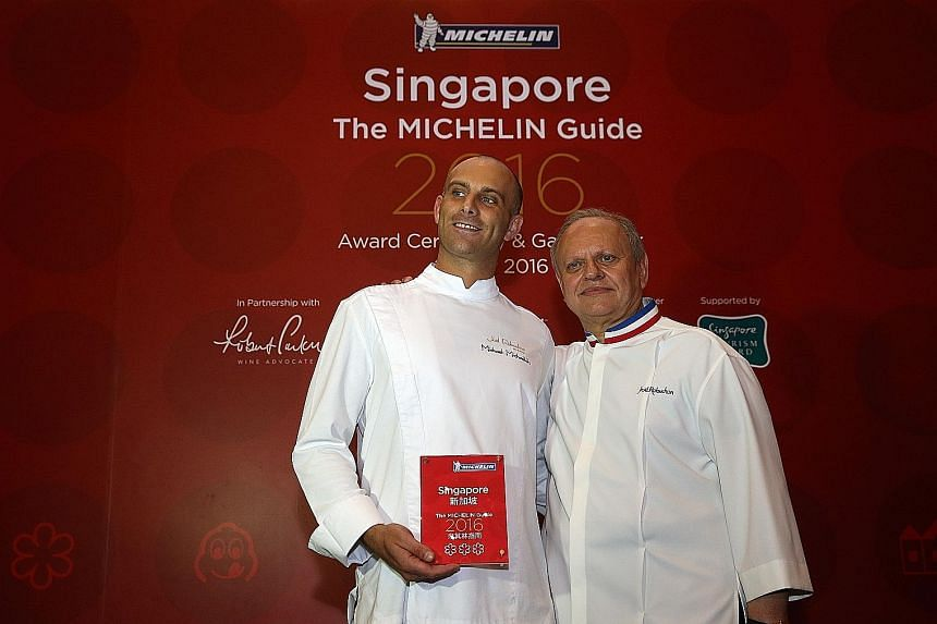 Chef Joel Robuchon (right) and executive chef Michael Michaelidis of Joel Robuchon Restaurant at Resorts World Sentosa, the only restaurant here to be awarded three Michelin stars.