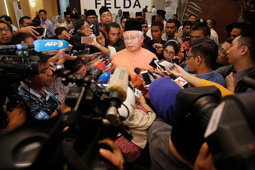 Malaysian Prime Minister Najib Razak speaking to journalists in Kuala Lumpur yesterday. He has said that those named in the suits, including his stepson Riza Aziz, have the right to legal process in the United States.