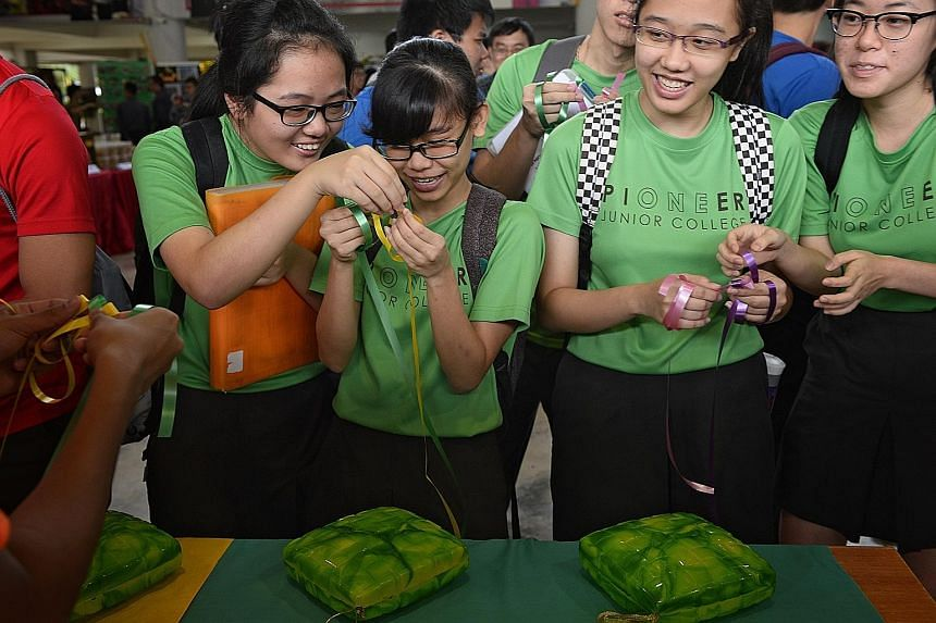 Students and staff from Pioneer Junior College marked Racial Harmony Day yesterday with cultural activities like weaving ketupat packets. The annual event was celebrated in many primary and secondary schools.