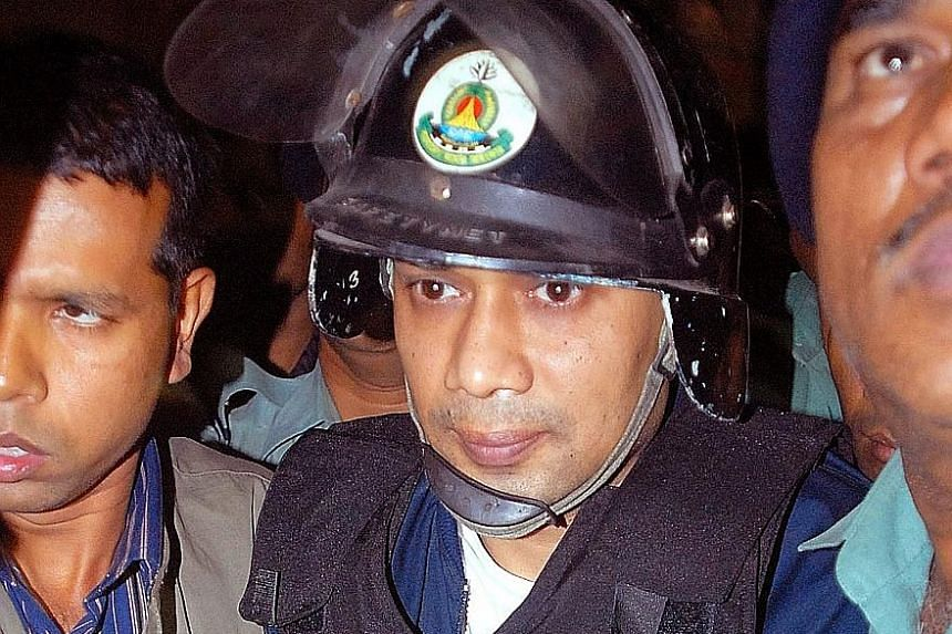 Tarique Rahman being escorted to court in 2007. He was convicted in absentia for money laundering and fined $3.4 million.