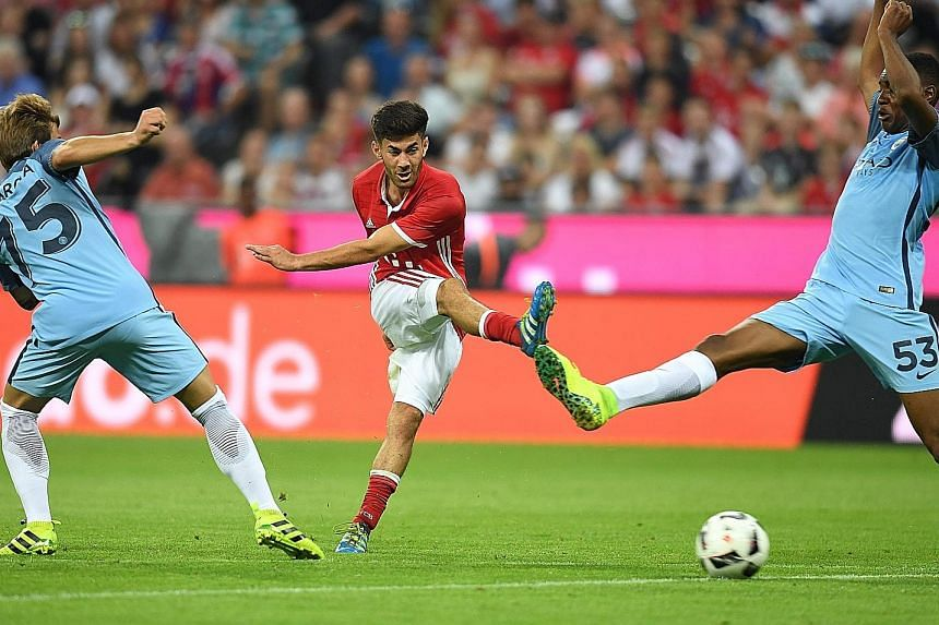 Hosts Bayern Munich's Erdal Ozturk (centre) scoring the goal that condemned Pep Guardiola to a loss in his first match as Manchester City manager. City will also play pre-season friendlies against Manchester United, Borussia Dortmund and Arsenal.