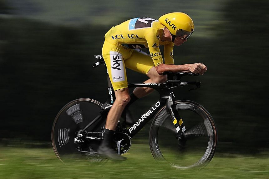 Chris Froome, wearing the overall leader's yellow jersey, riding to victory in the 18th stage of Tour de France between Sallanches and Megeve in the French Alps. He extended his lead over Bauke Mollema in the overall standings to 3min 52sec.