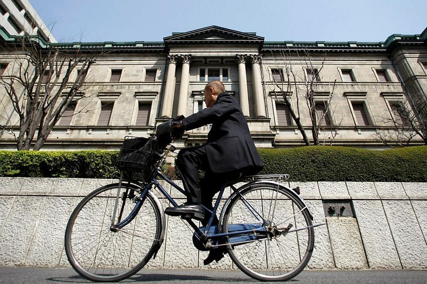 The Bank of Japan building in Tokyo. A Reuters poll showed 85 per cent of analysts expect the Japanese central bank to ease on Friday next week. The BOJ has already implemented negative interest rates and is printing 80 trillion yen (S$1 trillion) a