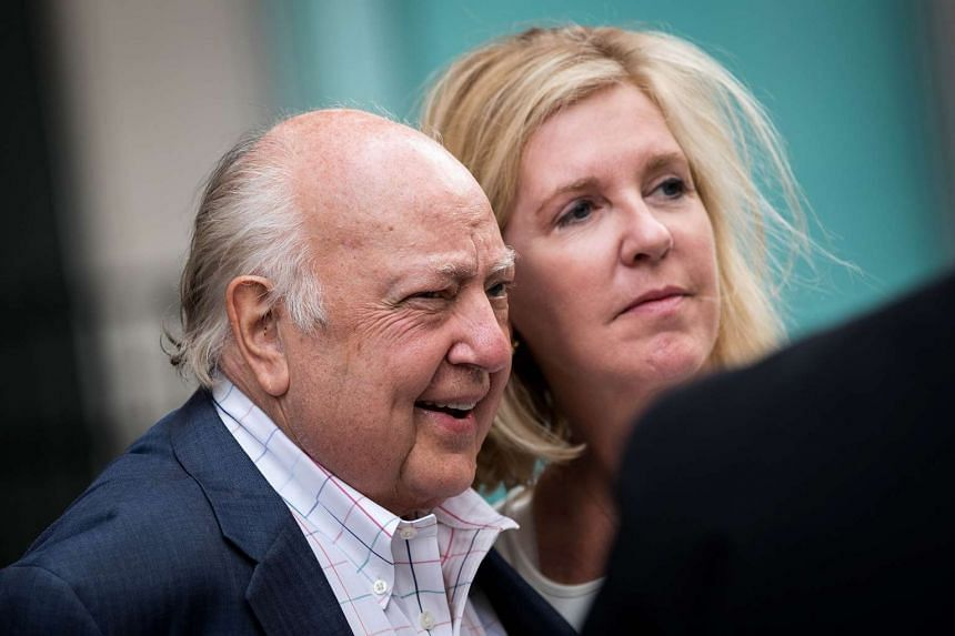 Fox News chairman Roger Ailes with wife Elizabeth Tilson as they leave the News Corp building, July 19, 2016.