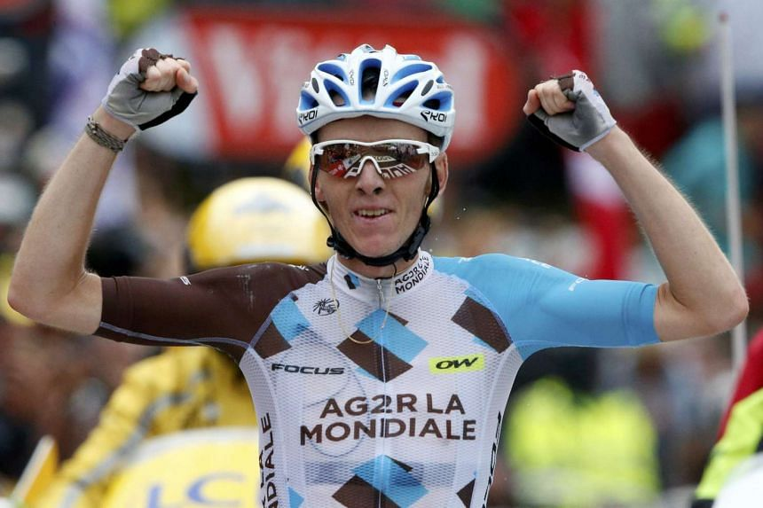Romain Bardet of France wins on the finish line.