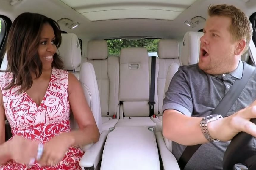 TV host James Corden appears shocked as US First Lady Michelle Obama gets in the car.