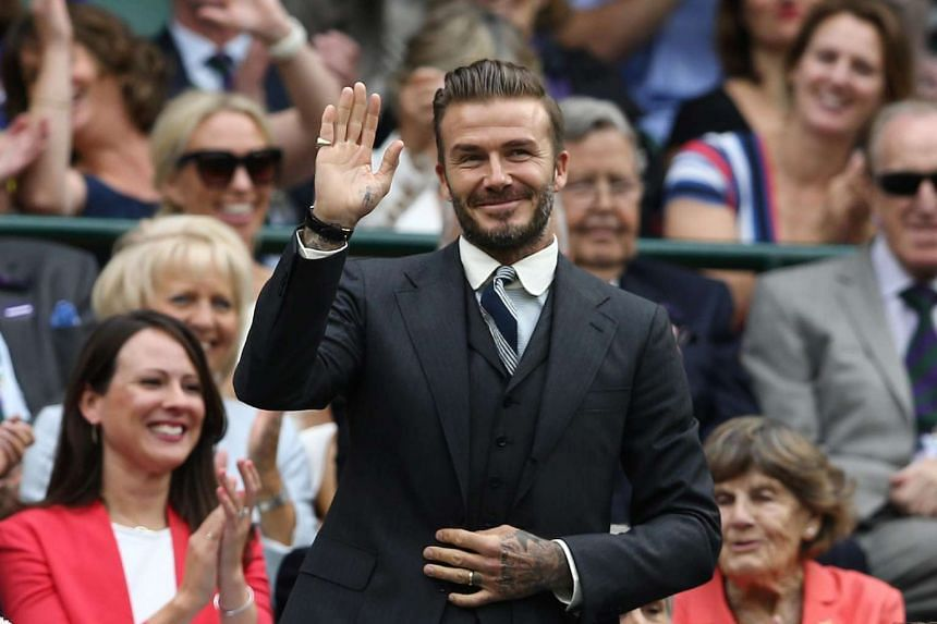 Former England footballer David Beckham stands in the royal box on centre court at the 2016 Wimbledon Championships.