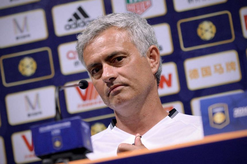 Manchester United's head coach Jose Mourinho looks on as he prepares to answer a question during a press conference ahead of the 2016 International Champions Cup football match between Manchester United and Dortmund in Shanghai on July 21.