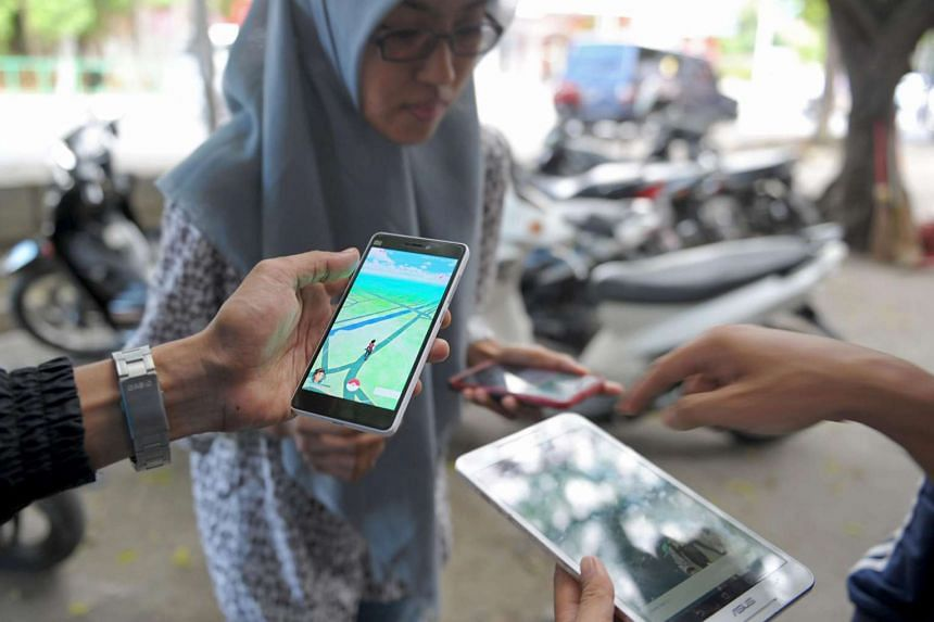 A group of Indonesians seen playing Pokemon Go on the streets in Banda Aceh in Indonesia on July 16.