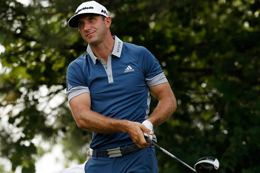 Dustin Johnson watches his tee shot on the 16th hole during the first round of the RBC Canadian Open at Glen Abbey Golf Club on July 21 in Oakville, Canada.