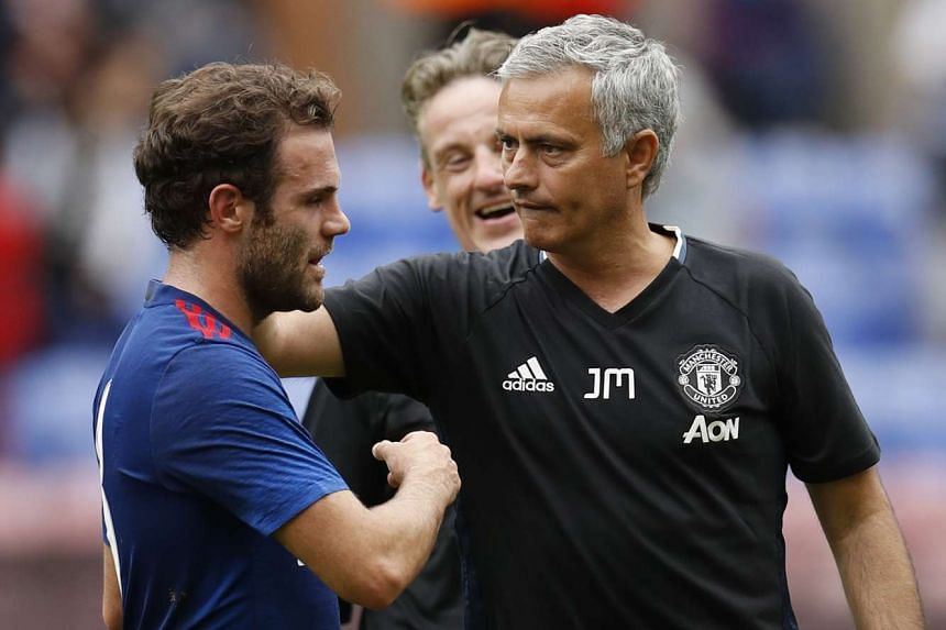 Manchester United manager Jose Mourinho (right) with Juan Mata after a pre-season friendly football match against Wigan Athletic, on July 16, 2016.