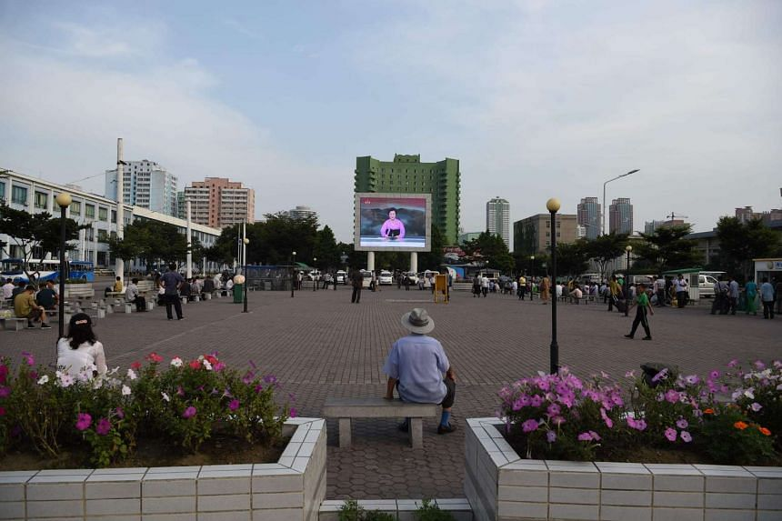 A giant screen broadcasts news in a public square in Pyongyang, on July 20, 2016.