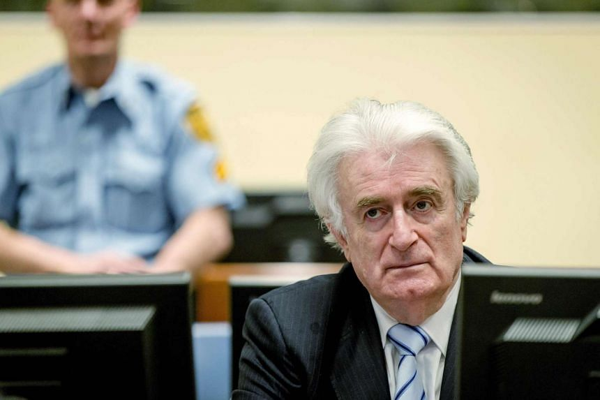 Bosnian Serb leader Radovan Karadzic sits in the courtroom for the reading of his verdict at the International Criminal Tribunal in The Hague, on March 24, 2016.