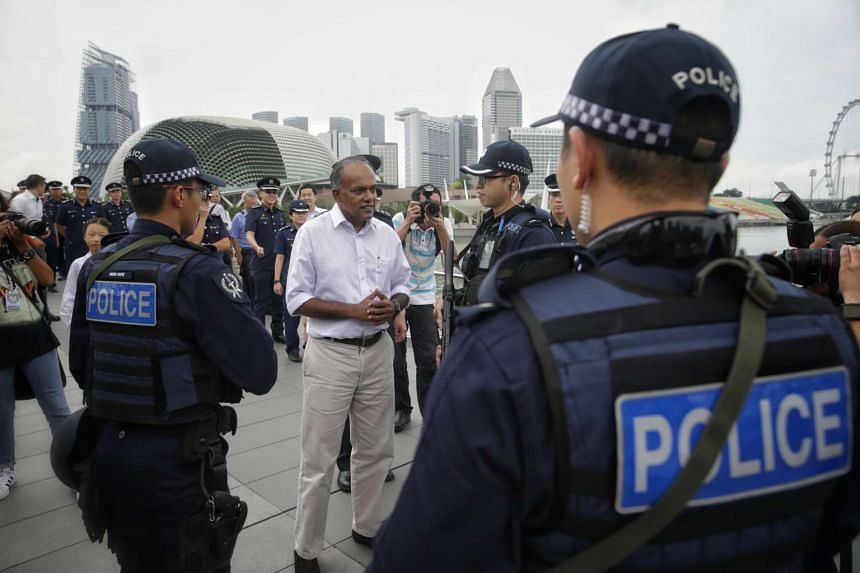 Minister for Home Affairs and Law K Shanmugam visiting the Emergency Response Team during their patrol along the Jubilee Bridge, on July 22, 2016.